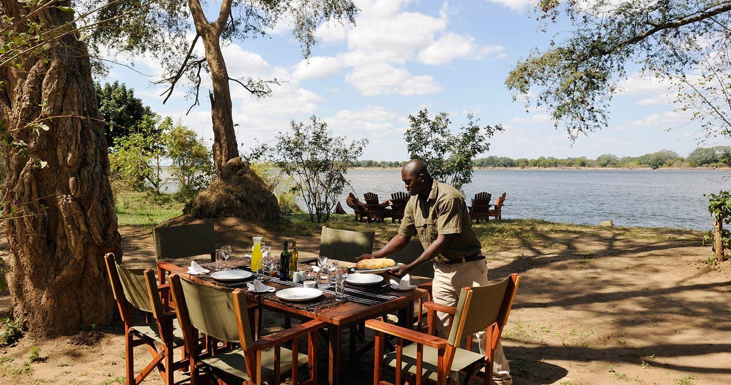 Enjoy a Romantic Dinner Next to the Zambezi River in Tsika Island Bush Camp